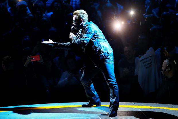Bono performing with U2 at the SSE Arena in Belfast. PA