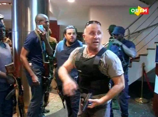 In this TV image taken from Mali TV ORTM, a security officer gives instructions to other security forces inside the Radisson Blu Hotel in Bamako, Mali, Friday Nov. 20, 2015. Men shouting