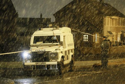 Police officers at the scene of a shooting incident in the Turflodge area of west Belfast, Northern Ireland on November 20 (Photo by Kevin Scott / Presseye)