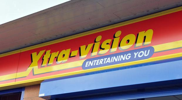 Eighteen jobs will be lost when the Xtra-vision DVD chain closes eight of its stores in Northern Ireland by the end of January