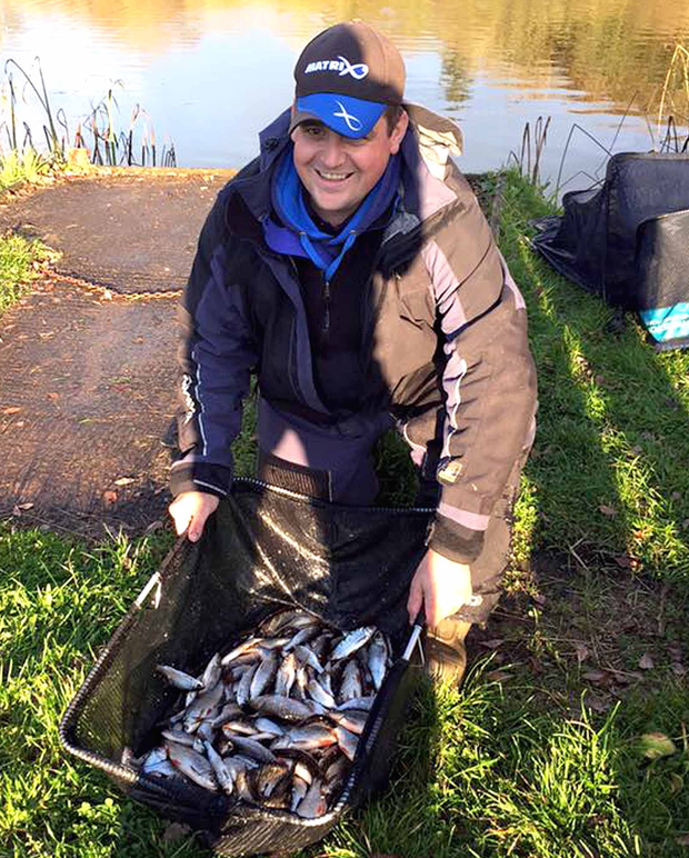 Net gain: Johnny McKinley after winning the Lurgan Coarse Angling Club match on Enagh Lough