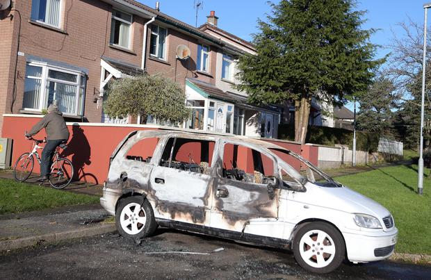 One of the cars which was set on fire at Dunclug Gardens in Ballymena in an overnight arson attack which the police are treating as a hate crime. Picture by Jonathan Porter/PressEye.