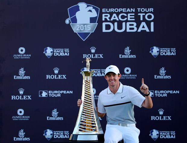 Rory McIlroy of Northern Ireland poses with the Race to Dubai trophy after he won the final round of DP World Tour Championship golf tournament in Dubai, United Arab Emirates. (AP Photo/Kamran Jebreili)