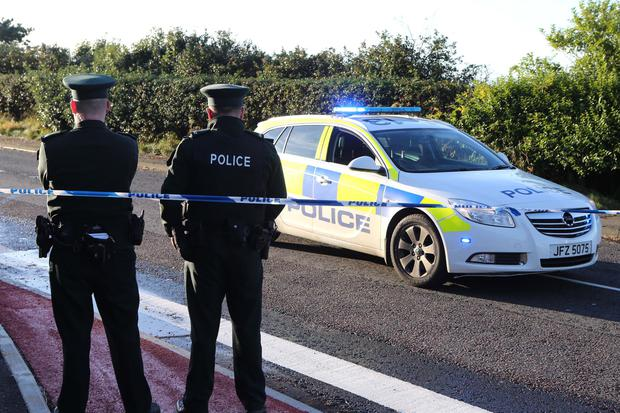 Police at the stretch of the Dunluce Road where the man's body was found on Sunday morning. Pic: Steven McAuley/McAuley Multimedia.