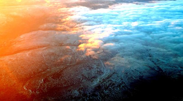 Snow capped hills over the Yorkshire Moors seen through an airplane window before approaching Newcastle Airport. Owen Humphreys/PA Wire