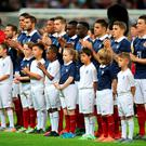 France players applaud prior to the international friendly match at Wembley Stadium