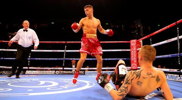 Big impact: Ryan Burnett knocks down Jason Booth during their British Bantamweight bout at the Manchester Arena