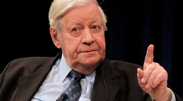 FILE - In this April 2, 2009 file photo former German Chancellor Helmut Schmidt makes a gesture during a discussion hosted by the ECB in Frankfurt, central Germany. Helmut Schmidt died Nov. 10, 2015. He was 96. (AP Photo/Daniel Roland, file)