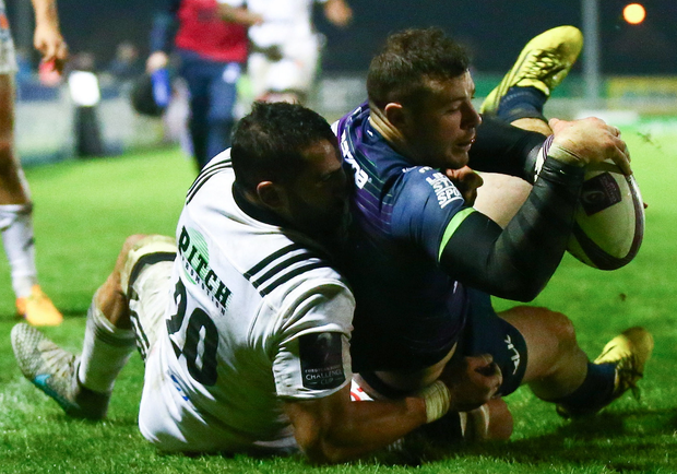 European Rugby Challenge Cup Round 2, Sportsground, Galway 21/11/2015 Connacht vs Brive Connacht's Robbie Henshaw is unable to ground the ball for his fourth try as he is tackled by Said Hireche of Brive Mandatory Credit ©INPHO/James Crombie