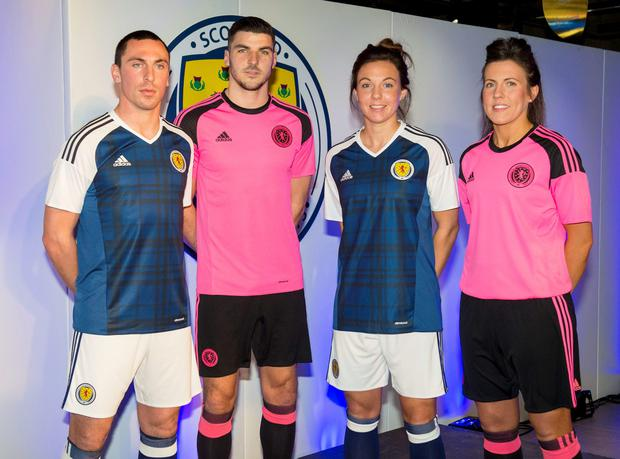 Handout photo dated 22/11/2015 provided by SNS of (L-R) Scotland's Scott Brown, Callum Paterson, Rachel Corsie and Leanne Crichton wearing the new Scotland home and away kits during the unveiling of the new Scotland kit at JD Sports Superstore, Glasgow. PRESS ASSSOCIATION Photo. Picture date: Sunday November 22, 2015. Photo credit should read: Alan Harvey/SNS/PA Wire. NOTE TO EDITORS: This handout photo may only be used in for editorial reporting purposes for the contemporaneous illustration of events, things or the people in the image or facts mentioned in the caption. Reuse of the picture may require further permission from the copyright holder.
