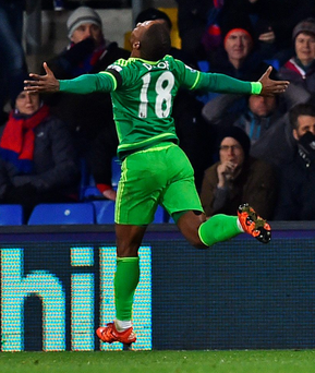 Crystal Palace's Scottish midfielder James McArthur (L) and Crystal Palace's French-born Congolese midfielder Yannick Bolasie (R) react as Sunderland's English striker Jermain Defoe (C) celebrates scoring the opening goal of the English Premier League football match between Crystal Palace and Sunderland at Selhurst Park in south London on November 23, 2015. AFP PHOTO / BEN STANSALL RESTRICTED TO EDITORIAL USE. No use with unauthorized audio, video, data, fixture lists, club/league logos or 'live' services. Online in-match use limited to 75 images, no video emulation. No use in betting, games or single club/league/player publications.BEN STANSALL/AFP/Getty Images