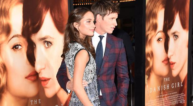 Actors Alicia Vikander and Eddie Redmayne attends the premiere of Focus Features'
