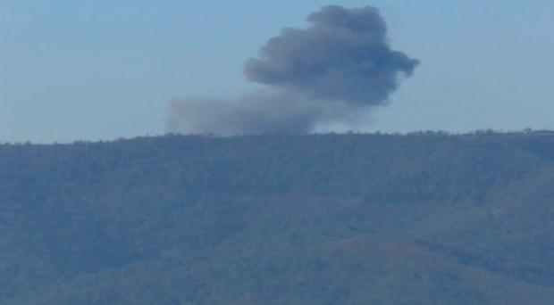 Smoke from a Russian warplane after crashing on a hill as seen from Hatay province, Turkey, Tuesday, Nov. 24, 2015. Russia denied that the plane crossed the Syrian border into Turkish skies.