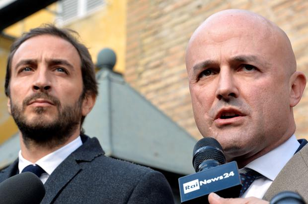 Journalists Gianluigi Nuzzi (R) and Emiliano Fittipaldi speak to reporters outside the Vatican on November 24, 2015, after the opening of a trial over the publication of classified documents. AFP/Getty Images