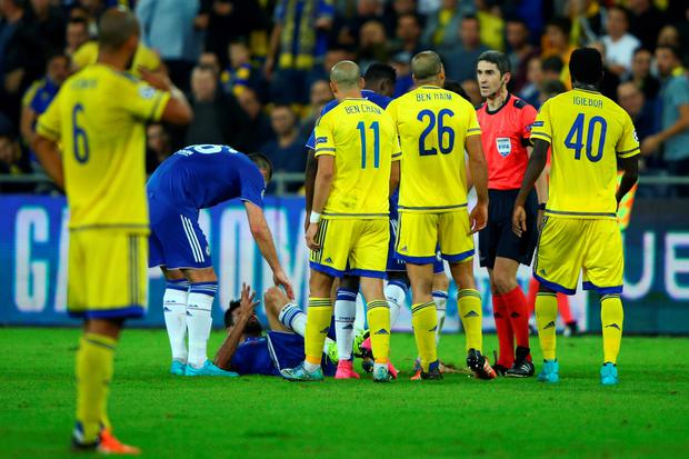 Tal Ben Haim of Maccabi Tel-Aviv is sent off by referee Alberto Undiano Mallenco for a late challenge on Diego Costa of Chelsea during the UEFA Champions League Group G match between Maccabi Tel-Aviv FC and Chelsea FC at Sammy Ofer Stadium on November 24, 2015 in Haifa, Israel. (Photo by Ian Walton/Getty Images)