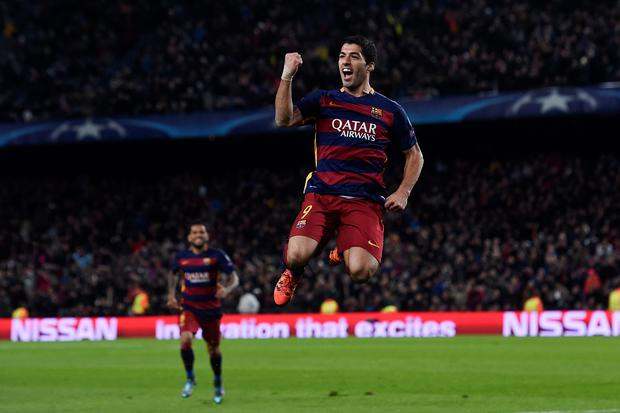 Barcelona's Uruguayan forward Luis Suarez celebrates after scoring during the UEFA Champions League Group E football match FC Barcelona vs AS Roma at the Camp Nou stadium in Barcelona on November 24, 2015. AFP PHOTO/ JOSEP LAGOJOSEP LAGO/AFP/Getty Images