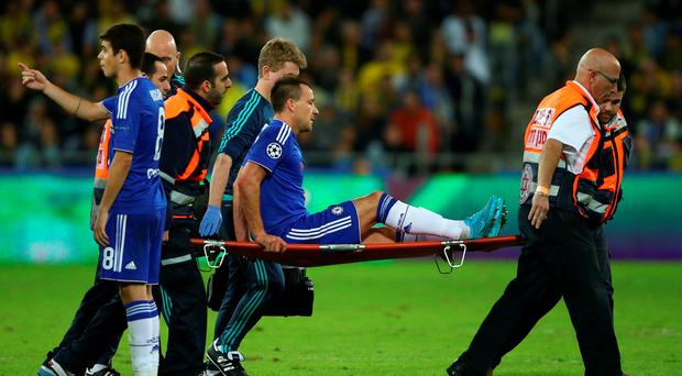 Chelsea captain John Terry is carried off much to the frustration of manager Jose Mourinho during his side's 4-0 Champions League win away to Maccabi Tel Aviv. Mourinho was fuming with the state of the pitch in Israel which he suggested played a part in Terry's injury, making the defender a major doubt for Sunday's vital Premier League game at Tottenham.