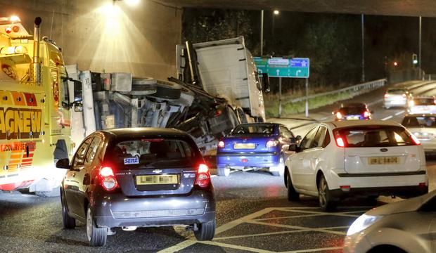 An overturned lorry blocks the inside lane on the Blacks road junction with the M1 on November 25 (Photo by Kevin Scott / Presseye )
