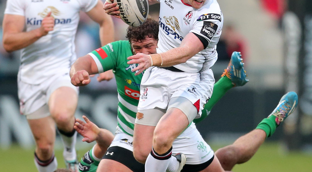 Under control: Ulster ace Peter Nelson skips through a tackle against Treviso