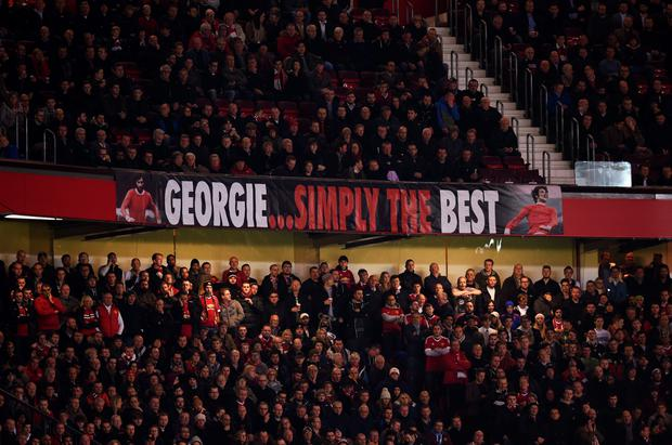 Fans display a banner as they remember former Manchester United player George Best during the UEFA Champions League Group B match between Manchester United FC and PSV Eindhoven at Old Trafford on November 25, 2015 in Manchester, United Kingdom. (Photo by Michael Regan/Getty Images)