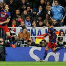 Real hiding: Luis Suarez jumps up high after scoring for Barcelona but even he can't see Terry Gibson