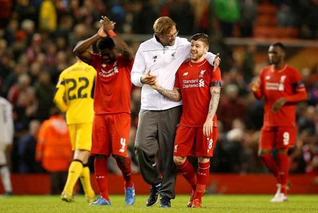 Liverpool manager Jurgen Klopp (centre) celebrates with Alberto Moreno (right) after the final whistle, during the UEFA Europa League match at Anfield, Liverpool. PRESS ASSOCIATION Photo. Picture date: Thursday November 26, 2015. See PA story SOCCER Liverpool. Photo credit should read: Peter Byrne/PA Wire