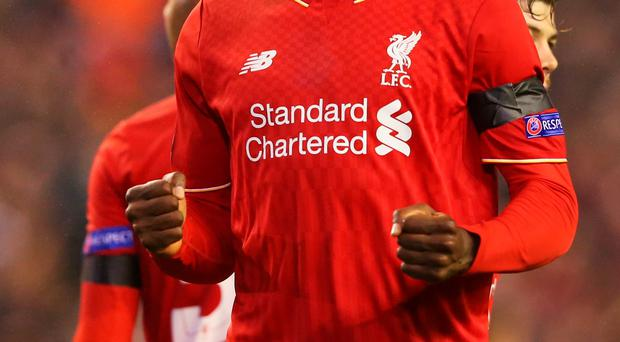 LIVERPOOL, ENGLAND - NOVEMBER 26: Christian Benteke of Liverpool celebrates as he scores their second goal during the UEFA Europa League Group B match between Liverpool FC and FC Girondins de Bordeaux at Anfield on November 26, 2015 in Liverpool, United Kingdom. (Photo by Alex Livesey/Getty Images)