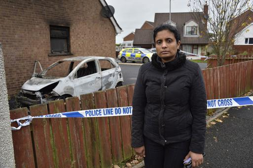 Subi Philip a Cardiac nurse from Antrim and who came from India pictured at her home which was targeted by petrol bombers and had her family car burnt out and the home damaged by flames. Photograph-Stephen Hamilton/ Presseye