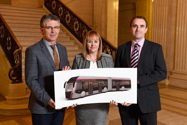 Transport Minister Michelle McIlveen pictured with Jan Van Hool (left) of Belgian-based company Van Hool which has been awarded a £19million contract to supply a fleet of 30 vehicles for the new Belfast Rapid Transit (BRT) system. Also pictured is John Marks (right) from Road Trucks Ltd, based in Larne, which will provide maintenance and specialist support services for the BRT vehicles. Picture: Michael Cooper