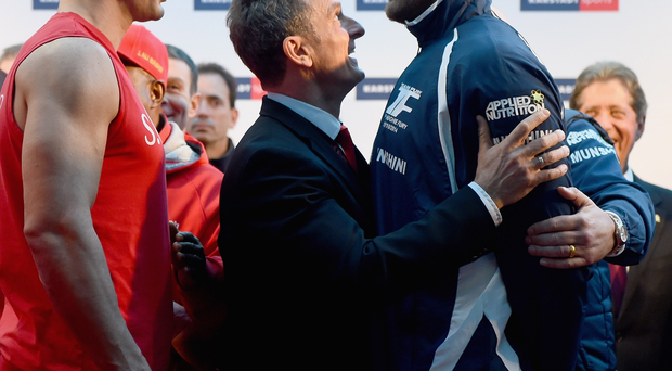 Face to face: Wladimir Klitschko and Tyson Fury square up during yesterday's weigh-in
