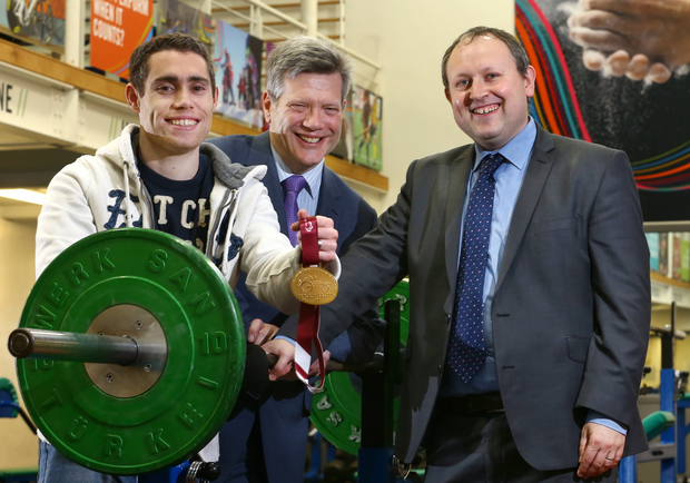 Golden moment: (from left) Sport NI-funded top athlete Jason Smyth shows off the IPC World Championship 100m gold medal he won last month in Doha, with Sport NI Interim chief executive Arthur Scott and Belfast Telegraph Sports Editor Steven Beacom
