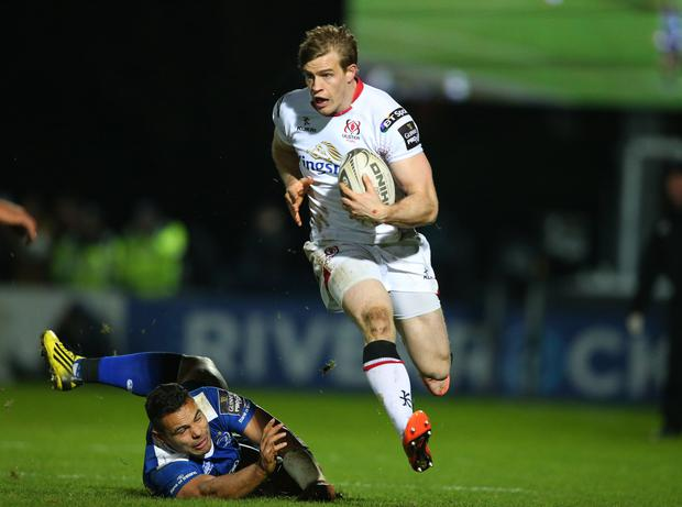 Top gear: Ulster's Andrew Trimble skips past Ben Te'o