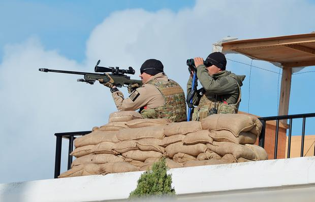 A pair of Maltese army security soldiers on rooftops (Photo by John Stillwell - Pool/Getty Images)