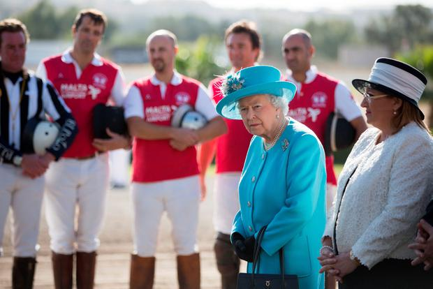 Queen Elizabeth II attends a prize giving ceremony with the President of Malta Marie Louise Coleiro Preca on a visit to Malta Racing Club at Marsa racecourse near Valetta, Malta. PA