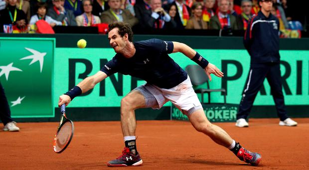 Great Britain's Andy Murray in action during day three of the Davis Cup Final at the Flanders Expo Centre, Ghent. Andrew Milligan/PA Wire.