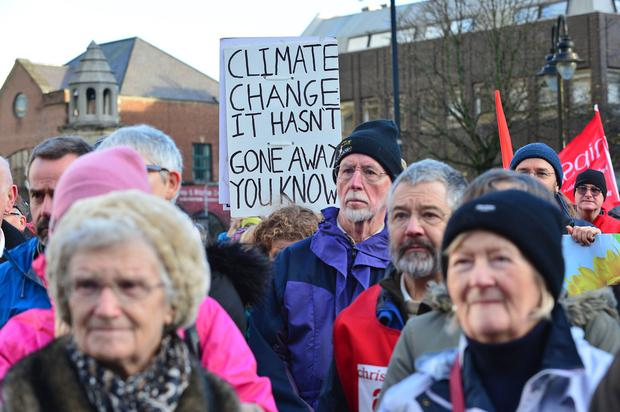Hundreds gather at a climate change rally in Belfast ahead of a UN summit on the issue in Paris. Pic: Arthur Allison.