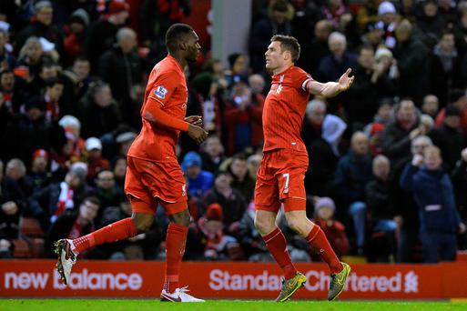 Liverpool's James Milner (right) celebrates scoring his sides first goal of the game during the Barclays Premier League match at Anfield, Liverpool. Martin Rickett/PA Wire.