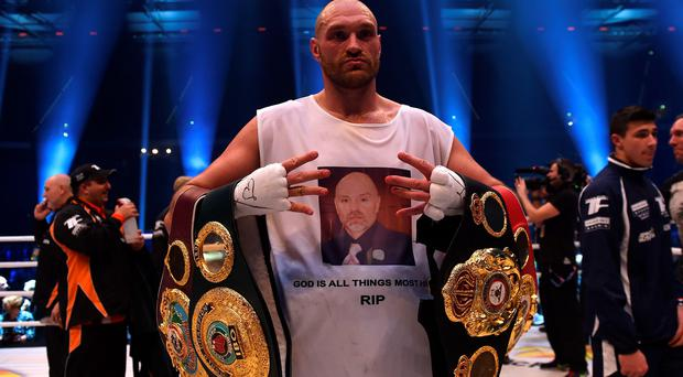 Tyson Fury celebrates defeating Wladimir Klitschko in Germany on Saturday night to become the IBF, IBO, WBO and WBA World Heavyweight Champion