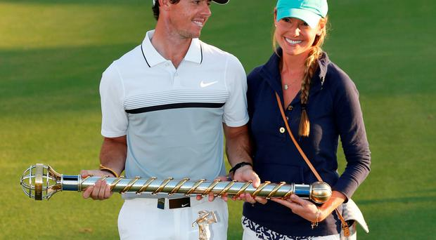 Rory McIlroy celebrates with Erica Stoll after winning the DP World Tour Golf Championship in Dubai.