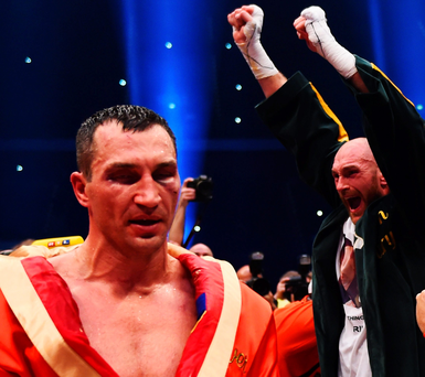 Joy division: Tyson Fury and his corner celebrate victory over Wladimir Klitschko to become new World Heavyweight Champion in three divisions