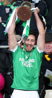Up for cup: Rockcorry captain Johnny Reilly lifts the cup