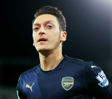 Net gains: Mesut Ozil opened the scoring for the Gunners