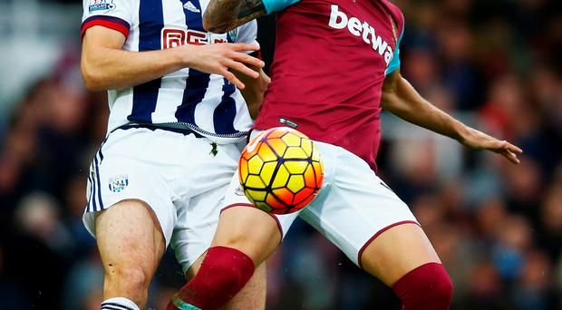 In battle: West Brom's Craig Dawson keeps a close eye on Mauro Zarate of West Ham