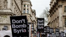 """LONDON, ENGLAND - NOVEMBER 28:  """"Don't Bomb Syria"""" signs crowd the skyline outside Downing Street against the possible British involvement in the bombing of Syria at Downing Street on November 28, 2015 in London, England. UK anti-war organisation, Stop the War Coalition, organised the protest in response to the proposed vote in Parliament by David Cameron to involve British forces in the bombing of ISIS targets in Syria. A similar protest in February 2003 against the British involvement in Iraq attracted a reported 2 million people to the streets of London.  (Photo by Chris Ratcliffe/Getty Images)"""