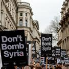 """Don't Bomb Syria"" signs crowd the skyline outside Downing Street against the possible British involvement in the bombing of Syria at Downing Street on November 28, 2015 in London, England"