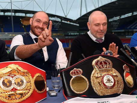(L-R) Asif Vali, Britain's world heavyweight champion Tyson Fury, trainer and uncle Peter Fury and father John Fury take part in a press conference in Bolton, north west England on November 30, 2015. Tyson Fury was crowned the new world heavyweight champion on November 28, ending Wladimir Klitschko's nine-year reign as champion in 12 rounds. AFP PHOTO/PAUL ELLISPAUL ELLIS/AFP/Getty Images