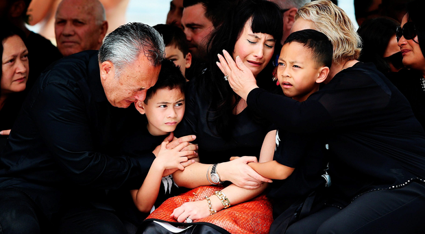 The widow of Jonah Lomu, Nadene Lomu, is comforted by her sons Brayley and Dhyreille and her mother and father Lois and Mervyn Kuiek during the public memorial for the New Zealand legend