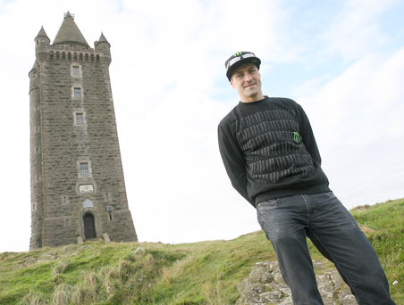 Towering above: Josh Brookes, pictured at Scrabo Tower, will be back in the World Superbike series in 2016 on BMW Motorrad machinery