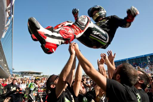 On a new high: Jonathan Rea celebrates his World title success