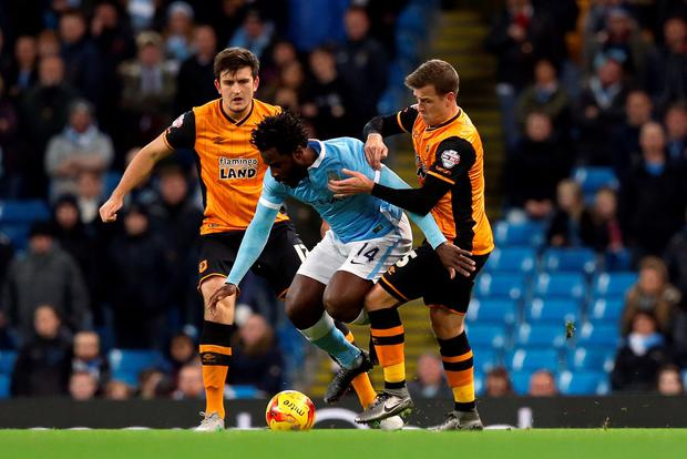 Manchester City's Wilfried Bony (centre) battles for the ball with Hull City's Harry Maguire (left) and Ryan Taylor (right) during the Capital One Cup, Quarter Final at the Etihad Stadium, Manchester. PA
